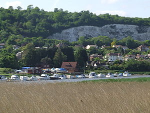 Halling, Kent - From Wouldham Marshes, over the Medway to houses in North Halling, with cliffs of Bore's Hole and May Wood to the top left.