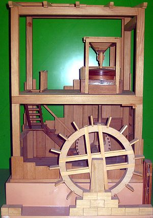 Watermill - Model of a Roman type Roman water-powered grain-mill described by Vitruvius. The millstone (upper floor) is powered by an undershot waterwheel by the way of a gear mechanism (lower floor)