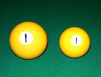 Russian pyramid - Comparison of the 68 mm (211⁄16 in) Russian and the 57 mm (21⁄4 in) common-style pool ball.