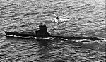 SH-3A Sea King of HS-8 flying over submarine in 1968.jpg