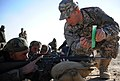 SSG Adam Sokolowski explains sight adjustments to an Afghan National Army soldier on the firing range at the Kabul Military Training Center.jpg