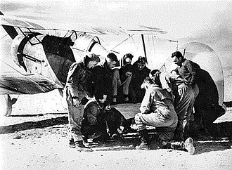 Gordon Steege - Flight Lieutenant Steege (fifth from right) and fellow No. 3 Squadron pilots with a Gladiator biplane in Egypt, c. January 1941