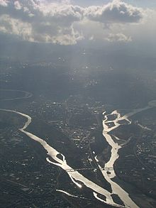 Aerial image showing two rivers meandering towards confluence near the bottom of the image.