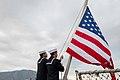 Sailors raise the national ensign. (15924291545).jpg