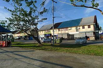 Sebauh - A row of wooden shoplots facing the river in Sebauh town.