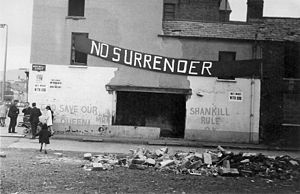 Shankill Road - Ulster loyalist banner and graffiti on a side street building off the Lower Shankill, early 1970s.