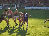Shaun McManus attempts a tackle during his farewell match.jpg
