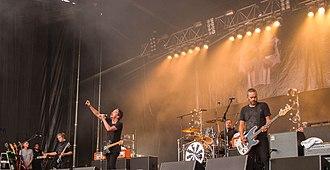 Shihad - Shihad performing at Grey Lynn Park, Auckland, in 2016.  Left to right: Phil Knight, Jon Toogood, Tom Larkin, Karl Kippenberger