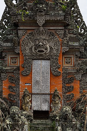 Bhoma - A representation of a Bhoma head guarding the top of the portal to a Balinese temple in Singapadu.