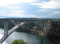 Reinforced concrete arch motorway bridge across Krka River