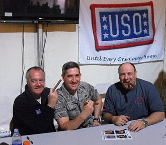 The Sopranos - Cast members James Gandolfini (right) and Tony Sirico (left) visit a member of the U.S. Air Force during a USO visit to Southwest Asia.
