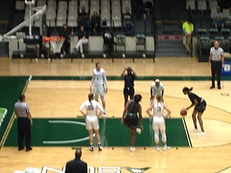 Women's basketball - A player from Webber International  (black jersey) attempts a free throw against Stetson University (white jerseys). November 30, 2018.