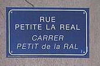 Perpignan - Perpignan street name sign in French and Catalan.