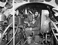 Sub Lieutenant K C J Robinson, at the controls of an X-Craft midget submarine in Rothesay Bay, Scotland, December 1944. A26933.jpg