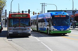 Community Transit - A Swift coach passing a parked Everett Transit bus at Everett Station