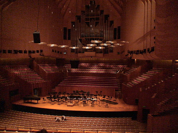 The Sydney Opera House's Concert Hall is an example of a large indoor classical music venue. It is home of the Sydney Symphony Orchestra. The rest of the building contains other amenities common at such music venues, such as cafes, restaurants, bars and retail outlets. Sydney Opera House Concert Theatre.JPG
