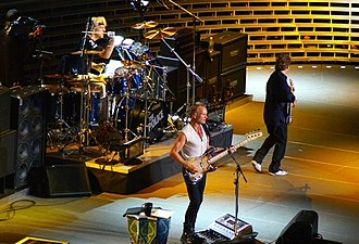The Police - Andy Summers (far right), Sting (front), Stewart Copeland (drums). The Police performing at Madison Square Garden, New York City on 1 August 2007.