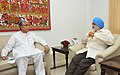 The Chief Minister of Tripura, Shri Manik Sarkar meeting the Deputy Chairman, Planning Commission, Shri Montek Singh Ahluwalia for finalizing plan size for 2013-14 for the State, in New Delhi on May 29, 2013.jpg
