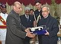 The President, Shri Pranab Mukherjee being presented a Silver Veena memento by the Governor of Telangana and Andhra Pradesh, Shri E.S.L. Narasimhan, in Hyderabad on June 30, 2015.jpg