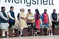 The Prime Minister, Shri Narendra Modi awarding the Digi-Dhan lucky draw winners, at Indoor Sports Complex, Mankapur, in Nagpur (5).jpg