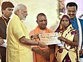 The Prime Minister, Shri Narendra Modi distributing the Sanction Letters to the identified beneficiaries of the Pradhan Mantri Awas Yojana (Rural), Rural at a function, in Lucknow, Uttar Pradesh (1).jpg