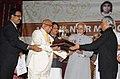 The Vice President, Shri Mohd. Hamid Ansari presenting the 13th A.K. Nair Memorial Award to the Principal Secretary to Prime Minister, Shri T.K.A. Nair, at Kannur, in Kerala on July 10, 2010.jpg
