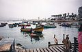 The harbour at Ancon Peru. Pelicans gather hopefully as the fish catch is gutted.jpg