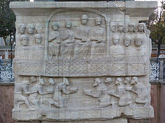 Gothic War (376–382) - The Obelisk of Theodosius (389) depicting Honorius, Arcadius, Theodosius I, and Valentinian II (top center). Court officials surround their sides, and on the lower tier Persians (left) and Goths (right) present gifts in supplication