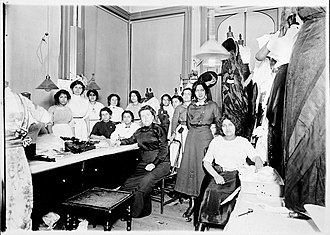 A. & L. Tirocchi Gowns - Anna Tirocchi (seated, in dark clothing) and her employees at the Butler Exchange shop, ca. 1912.