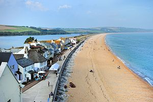 Torcross - Looking down on Torcross and Slapton Sands from Torcross Point. Slapton Ley is visible behind the houses.