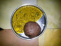Traditional south Indian (South Karnataka) specialitate made of red finger millet called Ragi mudde with pulses gravy.jpg