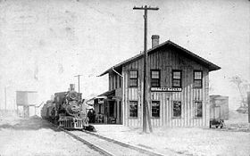 Train depot, Harpers Ferry, Iowa (circa 1913).jpg