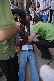 Treating an injured man in Tahrir during the June 28