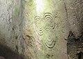 Triskele pattern on orthostat C10 at Newgrange.jpg