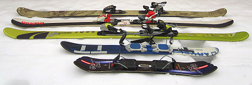 Twintip skis (back to front: backcountry ski, park ski with wood core, park ski with foam core, skiboards