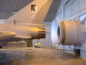 Hush house - A Eurofighter Typhoon in a hush house facility with an air-cooled exhaust detuner