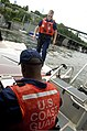 U.S. Coast Guard Machinery Technician 2nd Class Daniel Backman and Machinery Technician 2nd Class Ahmed Sanura, both with U.S. Coast Guard Station Seattle, perform a safety inspection on a vessel near Seattle 130526-G-AV652-101.jpg