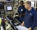 U.S. Coast Guard Petty Officer 1st Class Edwin Prince passes information to Chief Petty Officer Toby Robbins during Arctic Shield 2012 on the maritime security cutter USCGC Bertholf (WMSL 750) while in 120829-G-VS714-217.jpg