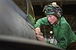 U.S. Marine Corps Cpl. Kristen F. Starkus installs a panel on an F-A-18C Hornet aircraft assigned to Marine Fighter Attack Squadron (VMFA) 323 in the hangar bay of the aircraft carrier USS Nimitz (CVN 68) 130619-N-TW634-127.jpg