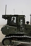 U.S. Marine Corps Lance Cpl. James R. Carver, a heavy equipment operator with Marine Wing Support Squadron (MWSS) 271, drives a tractor at Camp Bastion, Helmand province, Afghanistan, Aug. 7, 2013 130807-M-SA716-088.jpg
