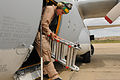U.S. Marine Corps Lance Cpl. Jonathan Lin, a crewmaster trainee with Marine Aerial Refueler Transport Squadron (VMGR) 234, hauls a ladder onto the flight line before conducting preflight checks on a KC-130 120411-M-ZD965-026.jpg