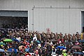 U.S. Marines and Sailors assigned to amphibious landing craft USS Anchorage (LPD 23), stand in formation behind audience members during the commissioning ceremony of the Anchorage at the Port of Anchorage 130504-M-ER853-126.jpg