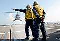 U.S. Navy Boatswain's Mate 3rd Class Matthew Fountain, left, and Boatswain's Mate 2nd Class Carlos Medina guide an Indonesian navy Bo105 helicopter during flight operations aboard the guided missile destroyer 130524-N-YU572-130.jpg