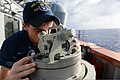 U.S. Navy Seaman Matthew Duggan, assigned to the guided missile cruiser USS Antietam (CG 54), takes a bearing from the ship Nov. 21, 2013, while underway in the Pacific Ocean 131121-N-TG831-082.jpg