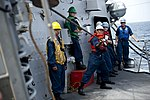 U.S. Sailors heave a line during an underway replenishment aboard the guided missile destroyer USS William P. Lawrence (DDG 110) Aug. 26, 2013, in the Arabian Sea 130826-N-ZQ631-061.jpg