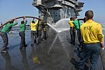 U.S. Sailors use fire hoses to wash down the flight deck of the aircraft carrier USS Harry S. Truman (CVN 75) March 9, 2014, in the Gulf of Oman 140309-N-CC806-160.jpg
