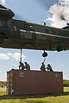U.S. Soldiers with the 390th Seaport Operations Company (SPOC) connect the reach pendants from a sling-loaded shipping container onto a CH-47 Chinook helicopter for sling load training as part of 130804-A-GT254-004.jpg