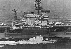USS Beacon (PG-99) with USS Kitty Hawk (CVA-63) c1970.jpg
