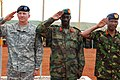 Maj. Gen. William B. Garrett III, commander of U.S. Army Africa, Gen. Nyakayirima Aronda, Chief of Defense Forces, Ugandan People's Defense Force, and Gen. Jeremiah Kianga, Chief of General Staff, Kenya, render honors during the opening ceremony for Natural Fire 10, Kitgum, Uganda, Oct. 16, 2009.