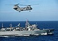 """US Navy 010412-N-0295M-002 A CH-46 Sea Knight assigned to the """"Gunbearers"""" of Helicopter Combat Support Squadron One One (HC-11), Detachment One, flies alongside the fast combat support ship USS Rainier (AOE 7).jpg"""